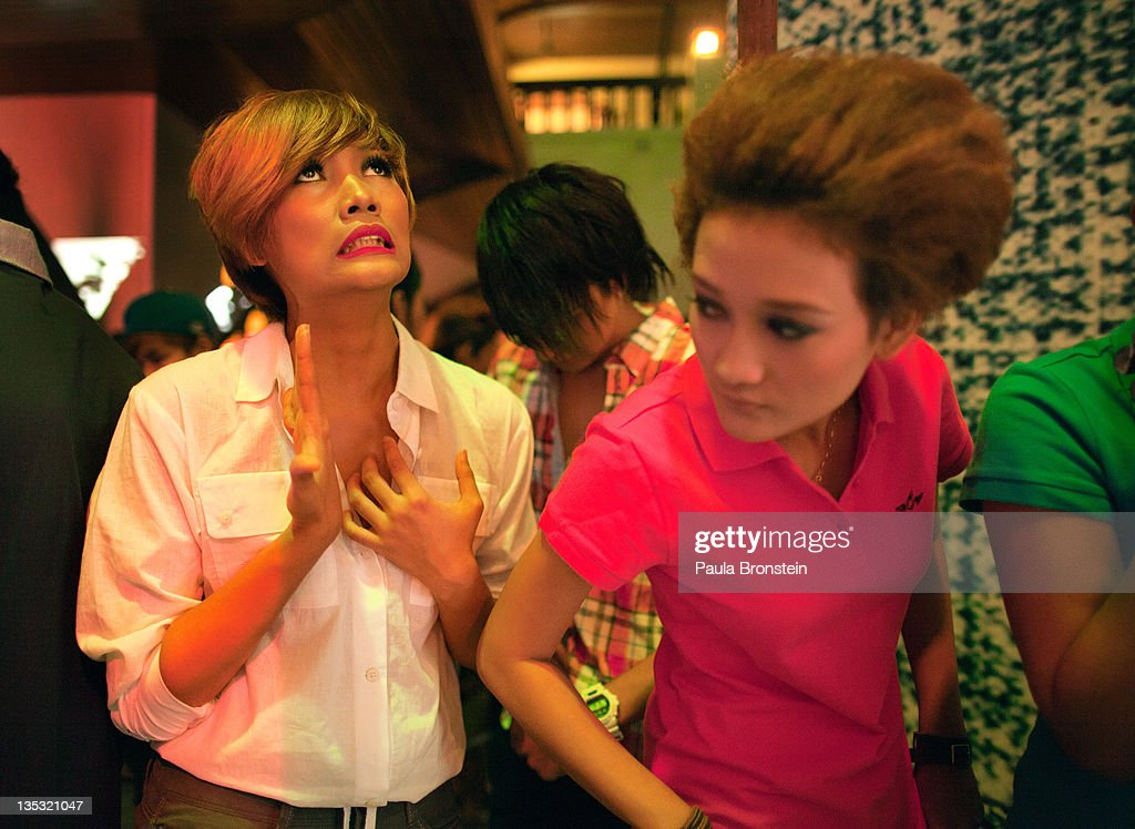 Jessica,21, (left) is nervous as she waits with other fashion models backstage for their signal to go on the boardwalk during a show featuring OPT jeans December 8, 2011 in Yangon, Myanmar. The pace of change in Myanmar brought U.S Secretary of State Hillary Clinton to the country where she discussed further paths to reform and crucial talks with both Aung San Suu Kyi and the highest levels of the Burmese government. For many years Myanmar has suffered from economic stagnation, political repression and international isolation. In March the army handed power to a civilian government after almost five decades of the military regime's strong arm rule. The handover took place after a controlled election under a new constitution that preserved much of the military clout. Internet has been loosened up as previously inaccessible foreign news and opposition websites have been unblocked.