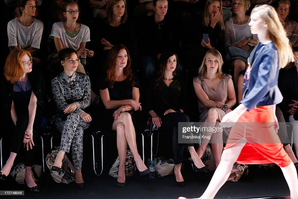 Jessica Joffe, Mina Tander, guest, Aylin Tezel, Anna Maria Muehe and Kristina Bazan watch the Schumacher Show during Mercedes-Benz Fashion Week Spring/Summer 2014 at Brandenburg Gate on July 4, 2013 in Berlin, Germany.
