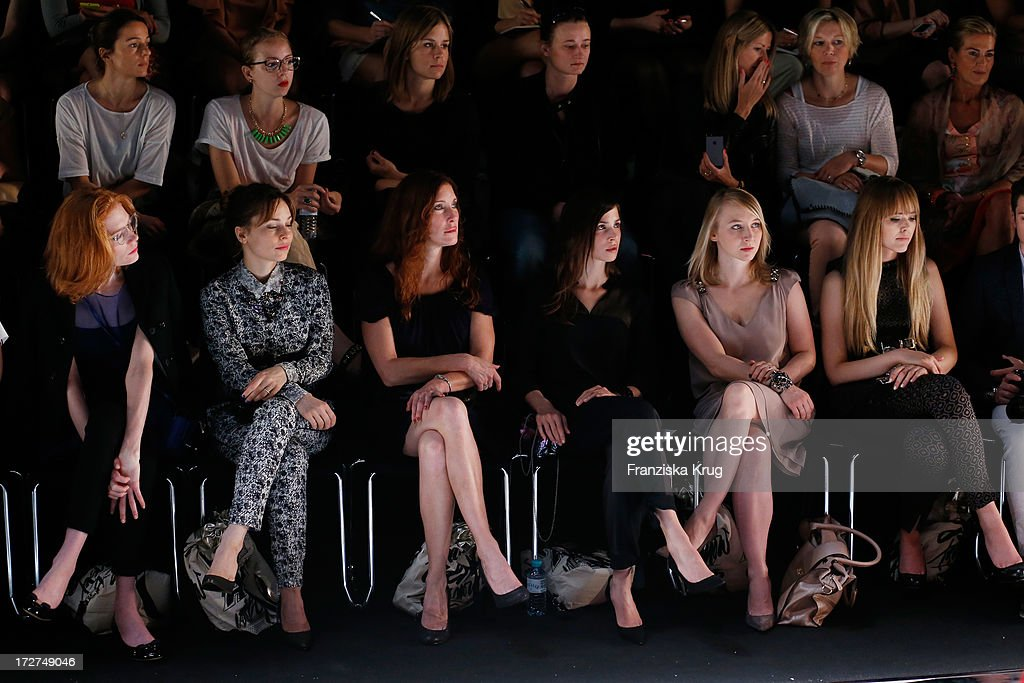 Jessica Joffe, Mina Tander, guest, Aylin Tezel, Anna Maria Muehe and Kristina Bazan watch the Schumacher Show during Mercedes-Benz Fashion Week Spring/Summer 2014 at Brandenburg Gate on July 4, 2013 in Berlin, Germany.