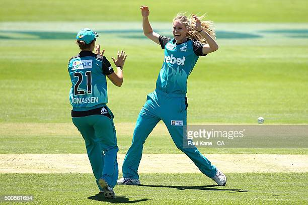 Jessica Jonassen and Holly Ferling of the Heat celebrate the wicket of Nicole Bolton of the Scorchers during the Women's Big Bash League match...