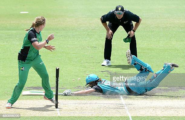 Jessica Jonassen of the Heat makes her ground as Morna Nielsen of the Stars attempts to run her out during the WBBL match between the Heat and Stars...