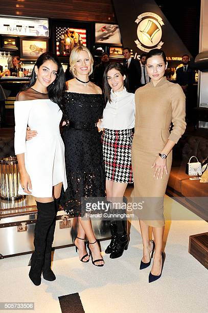 Jessica Kahawaty Karolina Kurkova Razane Jammal and Adriana Lima visit the IWC booth during the launch of the Pilot's Watches Novelties from the...