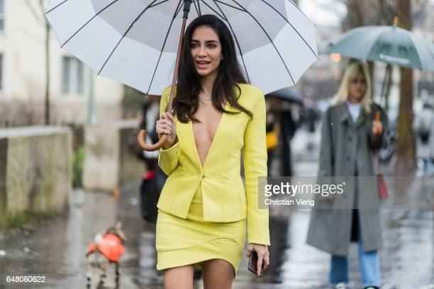Jessica Kahawaty wearing a yellow mini skirt and blazer outside Mugler on March 4 2017 in Paris France