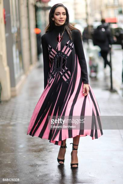 Jessica Kahawaty wears a black and pink dress outside the Valentino show during Paris Fashion Week Womenswear Fall/Winter 2017/2018 on March 5 2017...