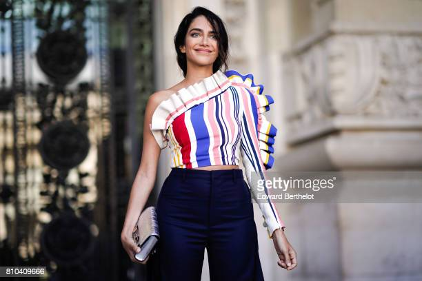 Jessica Kahawaty wears an off shoulder ruffled striped multicolor top flared pants outside the Ralph Russo show during Paris Fashion Week Haute...