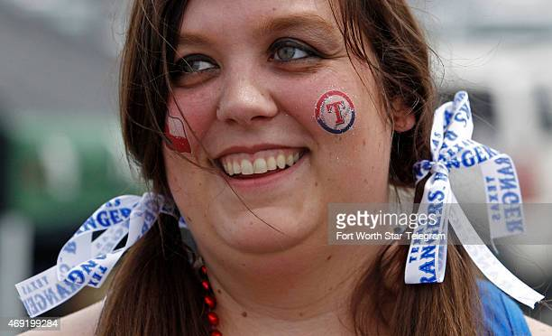 Jessica Knabe shows her team spirit with ribbons and rubon tattoos on opening day at home as the Texas Rangers play the Houston Astros at Globe Life...