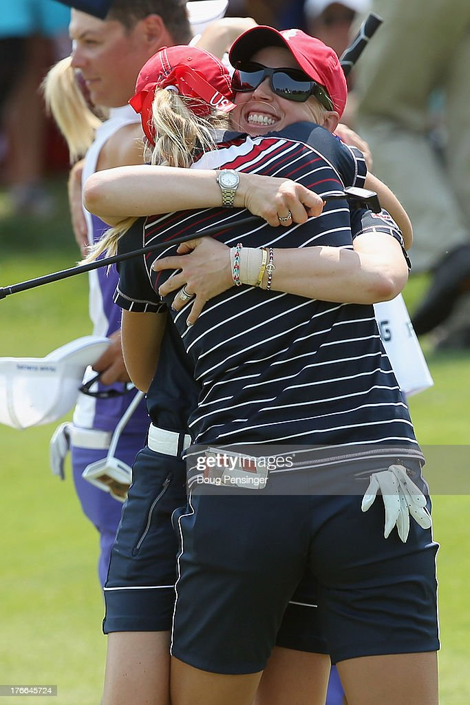 <a gi-track='captionPersonalityLinkClicked' href=/galleries/search?phrase=Jessica+Korda&family=editorial&specificpeople=5410628 ng-click='$event.stopPropagation()'>Jessica Korda</a> and <a gi-track='captionPersonalityLinkClicked' href=/galleries/search?phrase=Morgan+Pressel&family=editorial&specificpeople=213164 ng-click='$event.stopPropagation()'>Morgan Pressel</a> of the United States celebrate their 3&2 victory over Catriona Matthew of Great Britain and Jodi Ewart-Shadoff of Great Britain playing for the European Team on the 16th hole during the Friday morning foursomes matches at the 2013 Solheim Cup on August 16, 2013 at the Colorado Golf Club in Parker, Colorado.