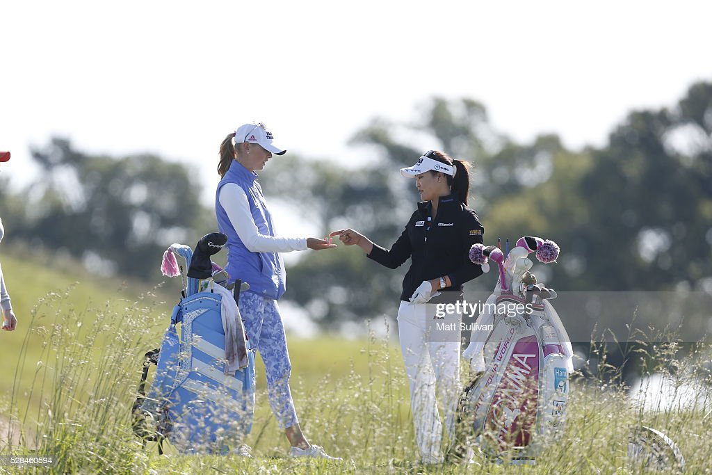 <a gi-track='captionPersonalityLinkClicked' href=/galleries/search?phrase=Jessica+Korda&family=editorial&specificpeople=5410628 ng-click='$event.stopPropagation()'>Jessica Korda</a> and So Yeon Ryu of South Korea talk before hitting their tee shot on the second hole during the Yokohama Tire Classic on May 05, 2016 in Prattville, Alabama.