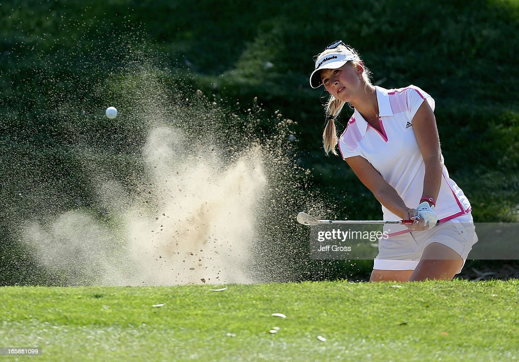 <a gi-track='captionPersonalityLinkClicked' href=/galleries/search?phrase=Jessica+Korda&family=editorial&specificpeople=5410628 ng-click='$event.stopPropagation()'>Jessica Korda</a> hits a bunker shot to the 17th green during the third round of the Kraft Nabisco Championship at Mission Hills Country Club on April 6, 2013 in Rancho Mirage, California.