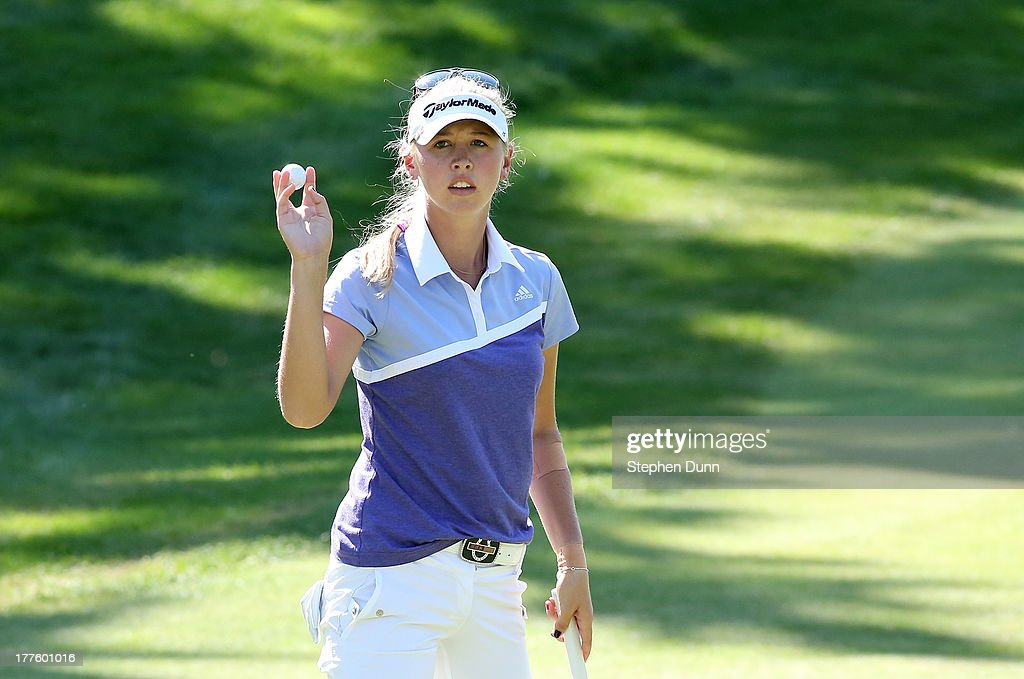 <a gi-track='captionPersonalityLinkClicked' href=/galleries/search?phrase=Jessica+Korda&family=editorial&specificpeople=5410628 ng-click='$event.stopPropagation()'>Jessica Korda</a> holds up her ball after making a birdie putt to finish her round on the 18th hole during the third round of the CN Canadian Women's Open at Royal Mayfair Golf Club on August 24, 2013 in Edmonton, Alberta, Canada.