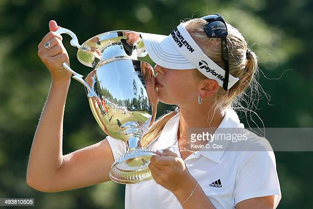 Jessica Korda kisses the trophy on the 18th green after winning the Airbus LPGA Classic presented by JTBC at the Crossings Course at the Robert Trent...