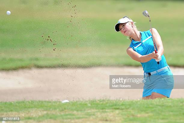Jessica Korda of the United States chips out of the bunker on the third hole during day two of the 2014 Ladies Masters at Royal Pines Resort on...