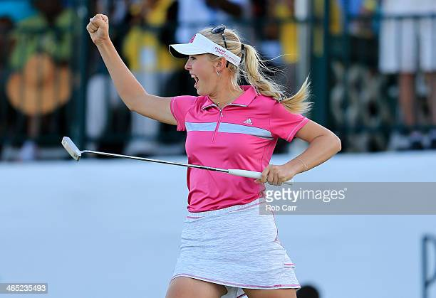 Jessica Korda of the USA celebrates after winning the final round of the Pure Silk Bahamas LPGA Classic at the Ocean Club course on January 26 2014...