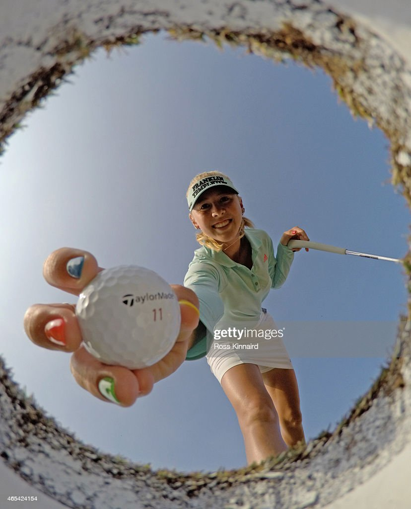 Jessica Korda of the USA take a ball out of the hole on the practice putting green during the third round of the HSBC Women's Champions at the...