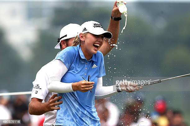 Jessica Korda of USA is splashed by water on the 18th hole after winning the Sime Daeby LPGA in the final round of the Sime Darby LPGA Tour at Kuala...