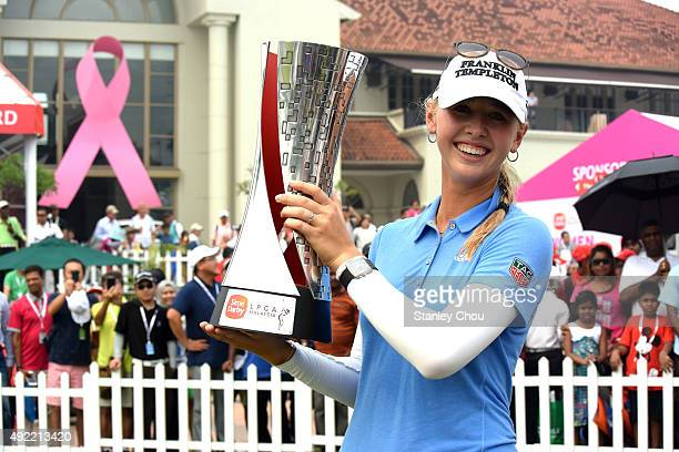 Jessica Korda of USA poses with the 2015 Sime Darby LPGA Tour trophy during the live TV presentation after the final round of the Sime Darby LPGA...