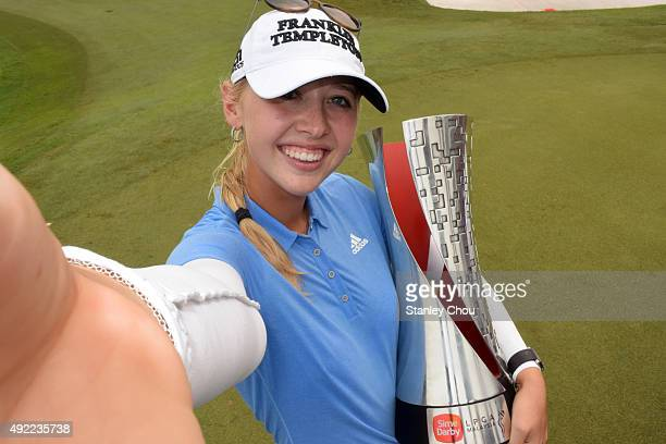 Jessica Korda of USA poses2 with the 2015 Sime Darby LPGA Tour trophy during the presentation ceremony after the final round of the Sime Darby LPGA...