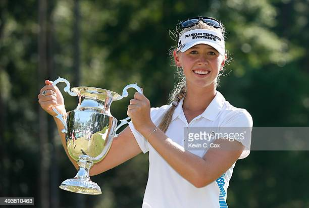 Jessica Korda poses with the trophy on the 18th green after winning the Airbus LPGA Classic presented by JTBC at the Crossings Course at the Robert...