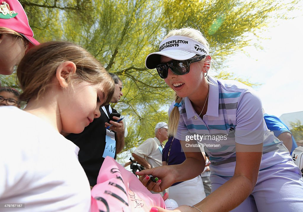 Jessica Korda signs autographs for young fans following the first round of the JTBC LPGA Founders Cup at Wildfire Golf Club on March 20, 2014 in Phoenix, Arizona.