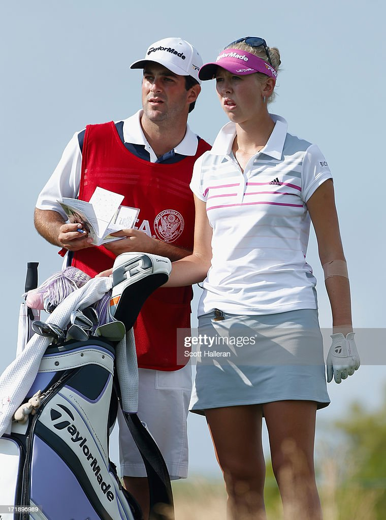 Jessica Korda waits on the 15th tee with her caddie/boyfriend Johnny DelPrete during the third round of the 2013 U.S. Women's Open at Sebonack Golf Club on June 29, 2013 in Southampton, New York.