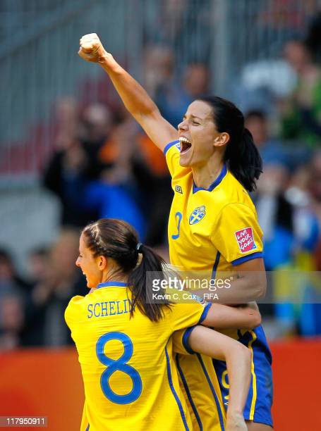 Jessica Landstrom and Lotta Schelin celebrate the first goal by Lisa Dahlkvist of Sweden against Korea DPR during the FIFA Women's World Cup 2011...