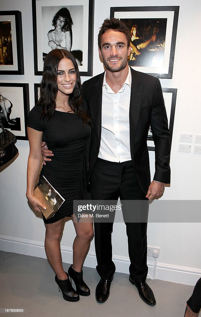 Jessica Lowndes (L) and Thom Evans attend a private view of 'Human Relations' featuring the photographs of Fenton Bailey and Mairi-Luise Tabbakh, curated by Sascha Bailey, at Imitate Modern on May 1, 2013 in London, England.