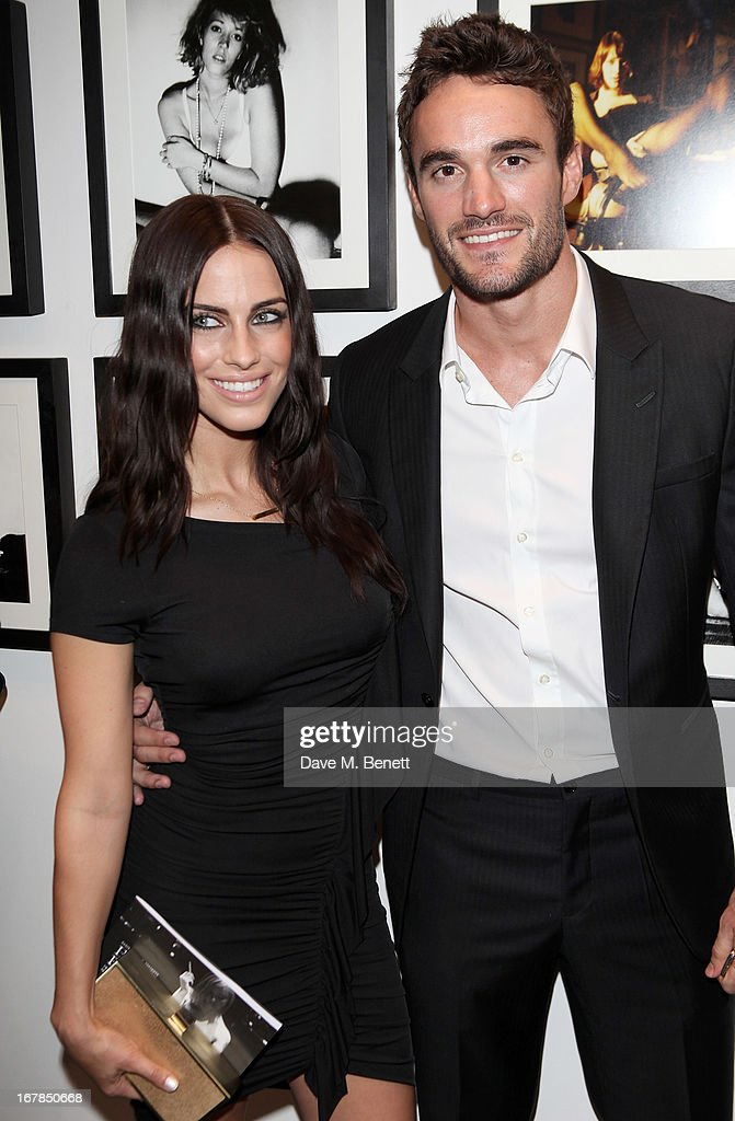 <a gi-track='captionPersonalityLinkClicked' href=/galleries/search?phrase=Jessica+Lowndes&family=editorial&specificpeople=3960270 ng-click='$event.stopPropagation()'>Jessica Lowndes</a> (L) and <a gi-track='captionPersonalityLinkClicked' href=/galleries/search?phrase=Thom+Evans&family=editorial&specificpeople=825883 ng-click='$event.stopPropagation()'>Thom Evans</a> attend a private view of 'Human Relations' featuring the photographs of Fenton Bailey and Mairi-Luise Tabbakh, curated by Sascha Bailey, at Imitate Modern on May 1, 2013 in London, England.
