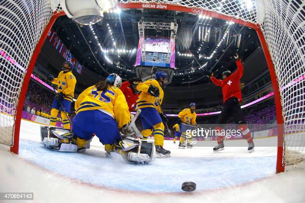 Jessica Lutz of Switzerland celebrates after scoring a thirdperiod goal against Valentina Lizana Wallner of Sweden during the Ice Hockey Women's...