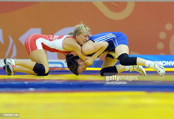 Jessica MacDonald of Canada and England's Jo Madyarchyk compete in the 51kg women's wrestling bronze match at the XIX Commonwealth Games in New Delhi...