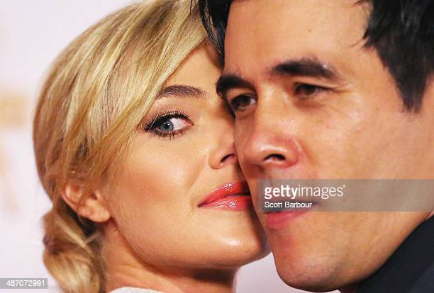Jessica Marais and James Stewart arrive at the 2014 Logie Awards at Crown Palladium on April 27 2014 in Melbourne Australia