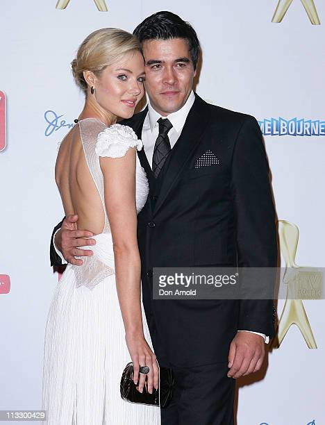 Jessica Marais and James Stewart arrive on the red carpet ahead of the 2011 Logie Awards at Crown Palladium on May 1 2011 in Melbourne Australia
