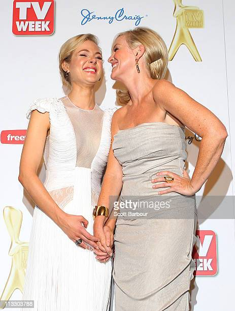 Jessica Marais and Rebecca Gibney pose in the media room during the 2011 Logie Awards at Crown Palladium on May 1 2011 in Melbourne Australia