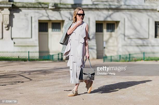 Jessica Mercedes Kirschner wearing Celine sunglasses a COS dress Gucci bag Puma sneaker outside Maison Margiela during the Paris Fashion Week...