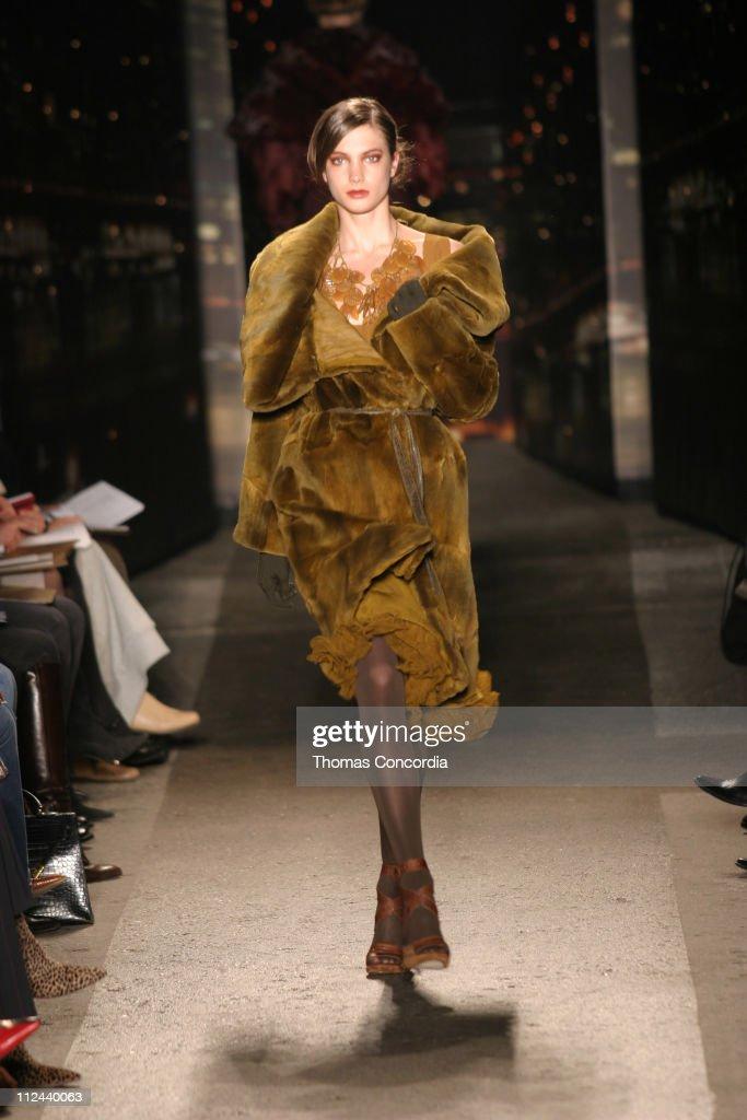 Jessica Miller wearing Donna Karan Fall 2004 during Olympus Fashion Week Fall 2004 Donna Karan Runway at Eyebeam in New York City New York United...