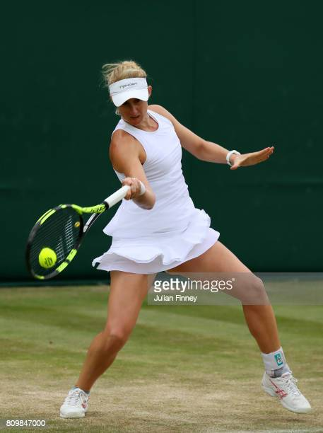 Jessica Moore of Australia plays a forehand during the Ladies Doubles first round match with Akiko Omae of Japan against Catherine Bellis of the...