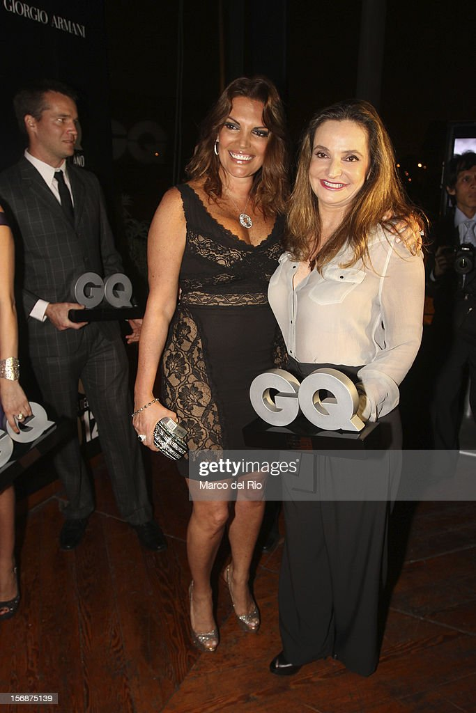Jessica Newton and bussineswoman Susana de la Puente pose during the awards ceremony GQ Men of the Year 2012 at La Huaca Pucllana on November 23, 2012 in Lima, Peru.