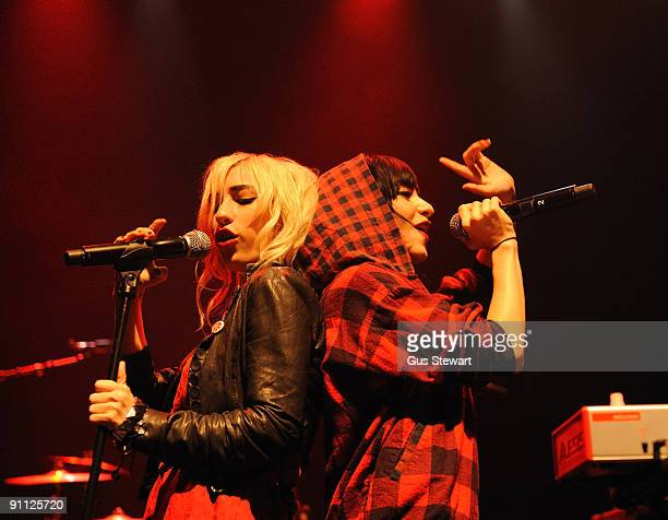 Jessica Origliasso and Lisa Origliasso of The Veronicas perform on stage at KOKO on September 24 2009 in London England