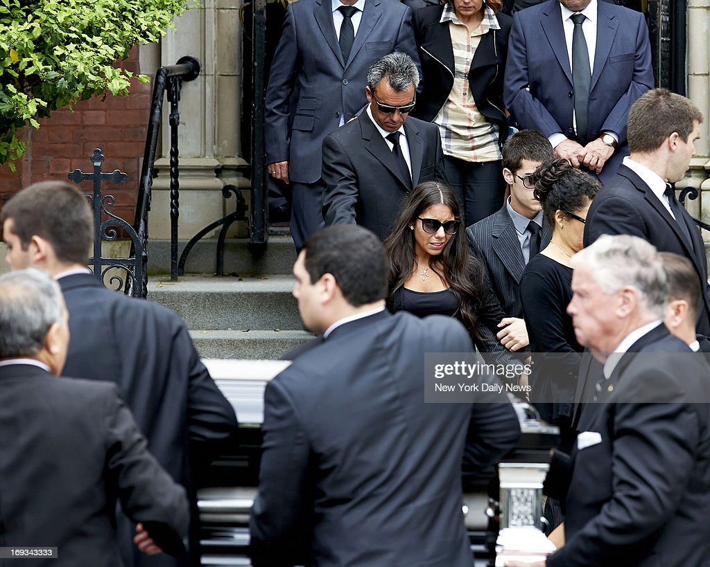 Jessica Rebello, twin sister of Andrea Rebello, and her dad Fernando (in black tie) leave Andrea's funeral at The Church of St. Theresa of Avila in Sleepy Hollow, N.Y. Rebello, of Tarrytown, N.Y., was shot to death by a Nassau County police officer who responded to a robbery of Rebello's off-campus home in Uniondale, L.I.