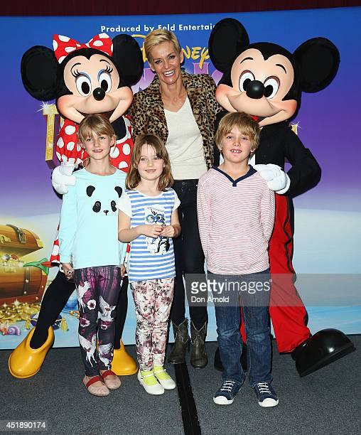 Jessica Rowe poses alongside family members at the Disney On Ice Premiere at Allphones Arena on July 9 2014 in Sydney Australia