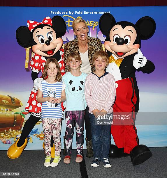 Jessica Rowe poses alongside her children at the Disney On Ice Premiere at Allphones Arena on July 9 2014 in Sydney Australia