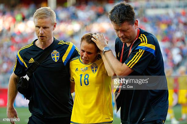 Jessica Samuelsson of Sweden is helped off the pitch after a head injury in the second half against the United States in the FIFA Women's World Cup...