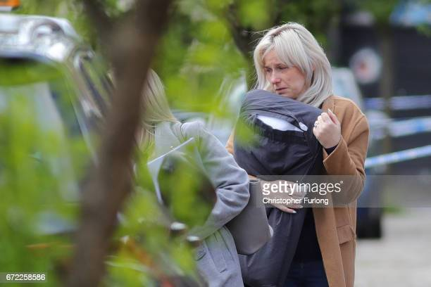 Jessica Samwell widow of exRoyal Navy officer Michael Samwell who was fatally injured as he confronted thieves outside his home visit the scene...