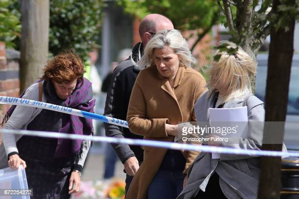 Jessica Samwell widow of of exRoyal Navy officer Michael Samwell who was fatally injured as he confronted thieves outside his home visit the scene in...