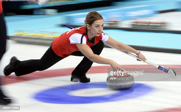 US Jessica Schultz trows the stone during the Women's Curling Round Robin Session 9 against Sweden at the Ice Cube Curling Center during the Sochi...
