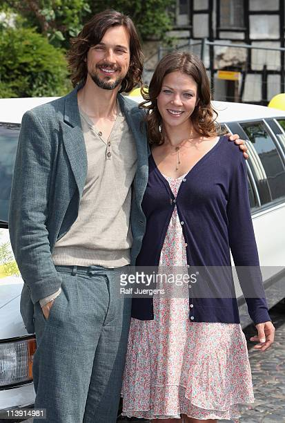 Jessica Schwarz and Florian David Fitz pose during the photocall for the movie 'Jesus Loves Me' on May 10 2011 in Bergisch Gladbach Germany