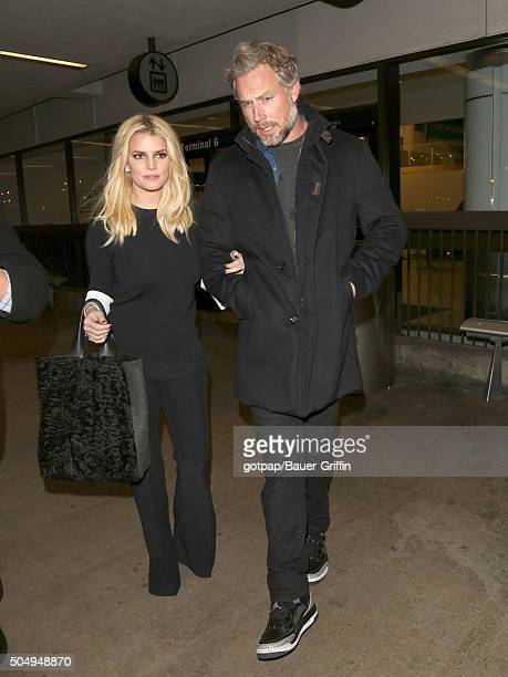 Jessica Simpson and Eric Johnson are seen at Los Angeles International Airport on January 13 2016 in Los Angeles California