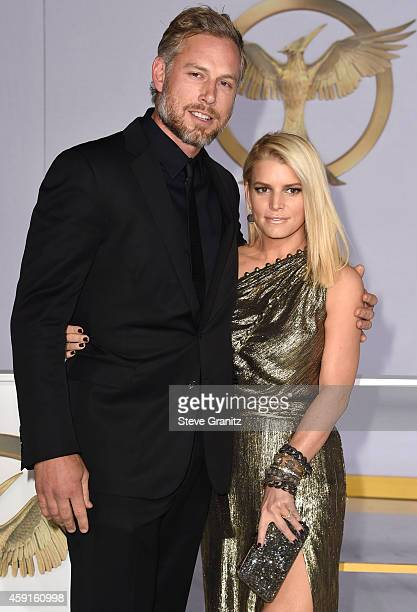 Jessica Simpson and Eric Johnson arrives at the 'The Hunger Games Mockingjay Part 1' Los Angeles Premiere at Nokia Theatre LA Live on November 17...