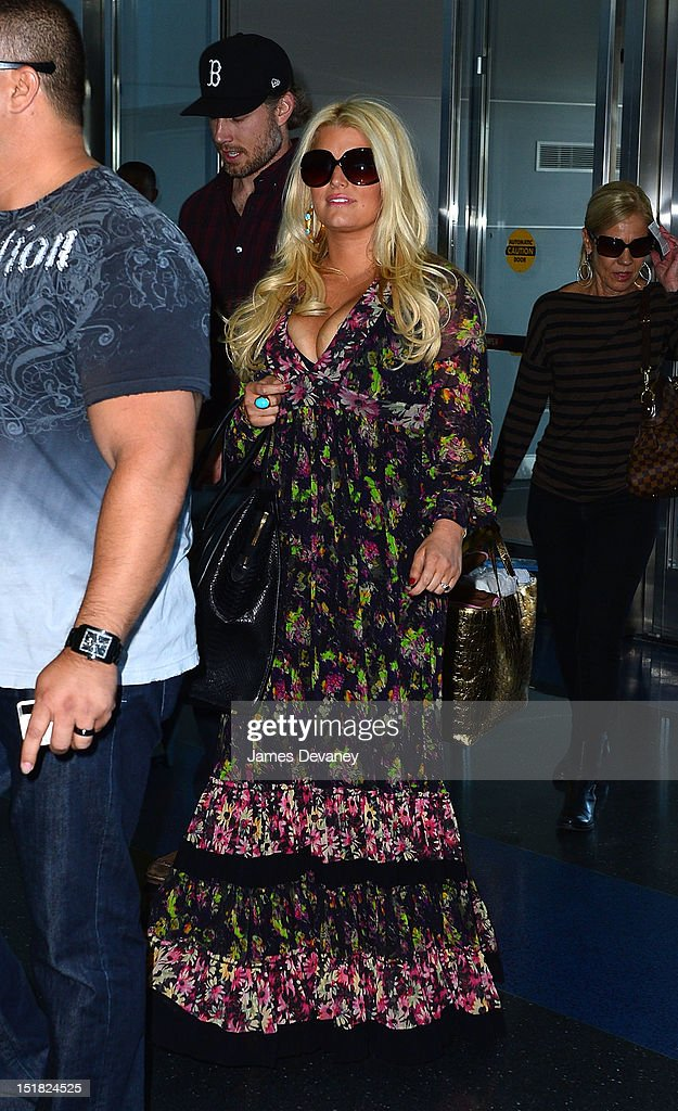 <a gi-track='captionPersonalityLinkClicked' href=/galleries/search?phrase=Jessica+Simpson&family=editorial&specificpeople=171513 ng-click='$event.stopPropagation()'>Jessica Simpson</a> arrives to JFK airport for her departing flight on September 11, 2012 in New York City.