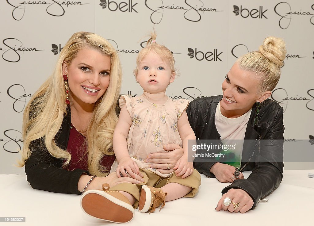 Jessica Simpson, wearing Jessica Simpson Maternity, with her daughter Maxwell Johnson and Ashlee Simpson, wearing a Jessica Simpson dress, visit Belk Southpark on March 23, 2013 in Charlotte, North Carolina.