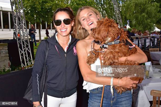 Jessica Springsteen and Hilary McNerney with dog Happy during the Global Jumping at Longines Global Champions Tour at Sommergarten unter dem Funkturm...